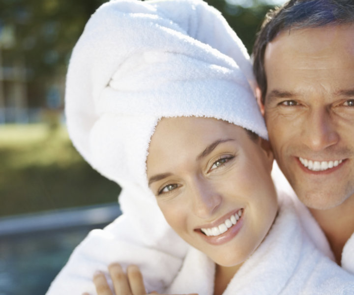 Portrait of happy loving couple enjoying their vacations together at spa